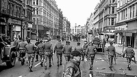 British soldiers seal off Royal Avenue, Belfast, N Ireland, following an explosion outside the former Grand Central Hotel in March 1974. The hotel  became even more of a target after it was taken over by the British Army as as a base and billet. 197403000216b.<br /> <br /> Copyright Image from Victor Patterson, 54 Dorchester Park, Belfast, UK, BT9 6RJ<br /> <br /> t1: +44 28 9066 1296 (from Rep of Ireland 048 9066 1296)<br /> t2: +44 28 9002 2446 (from Rep of Ireland 048 9002 2446)<br /> m: +44 7802 353836<br /> <br /> victorpattersonbelfast@gmail.com<br /> victorpatterson@me.com<br /> <br /> www.victorpatterson.com<br /> <br /> Please see my Terms and Conditions of Use at https://www.victorpatterson.com/page2<br /> It is IMPORTANT that you familiarise yourself with them.<br /> <br /> Images used on the Internet incur an additional cost and must be visibly watermarked i.e. © Victor Patterson within the body of the image and copyright metadata must not be deleted. Images used on the Internet have a size restriction of 4kbs and are chargeable at rates available at victorpatterson.com.<br /> <br /> This image is available only for the use of the download recipient i.e. television station, newspaper, magazine, book publisher, etc, and must not be passed on to any third party. It is also downloaded on condition that each and every usage is notified within 7 days to victorpatterson@me.com<br /> <br /> The right of Victor Patterson (or the named photographer) to be identified as the author is asserted in accordance with The Copyright Designs And Patents Act (1988). All moral rights are asserted.