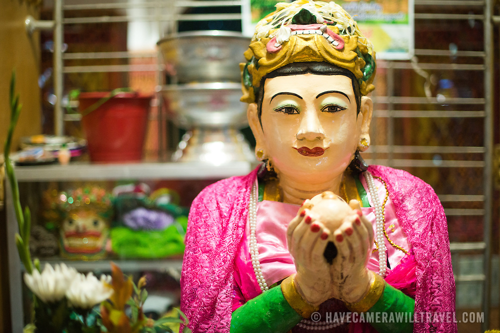 A statue of the Ogress Sandha Mukkhi (San Dha Mukhi) offering up her breast. Legend has it that she ruled Mandalay Hill, but that when the Buddha came they prayed together and pilgrims came to make offerings to the Buddha. She had nothing to offer, so she sliced off her breasts and offered them to the Buddha with the condition that she would one day be the King of Mandalay. He agreed, and reincarnated her 2400 years later as King Mindon. Sitting on top of Mandalay Hill, Sutaungpyei Pagoda features a large ornately decorate patio that offers scenic views out over the plain on which the city of Mandalay sits.