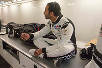 Ahmad Al Harthy during team debrief after warm Sunday morning warm up as part of the British GT Championship - Rockingham at Rockingham, Corby, Northamptonshire, United Kingdom. May 05 2014. World Copyright Peter Taylor/PSP. Copy of publication required for printed pictures.  Every used picture is fee-liable. http://archive.petertaylor-photographic.co.uk<br /> Ahmad Al Harthy