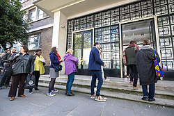 © Licensed to London News Pictures. 23/04/2017. London, UK. Thousands of French nationals queue outside the Lycee Francais Charles de Gaulle in South Kensington to vote in the first round of the French Presidential Election, some waiting for more than three hours to cast their ballot. An estimated 100,000 French nationals live in Britain, mostly in London and the surrounding area. Photo credit: Rob Pinney/LNP