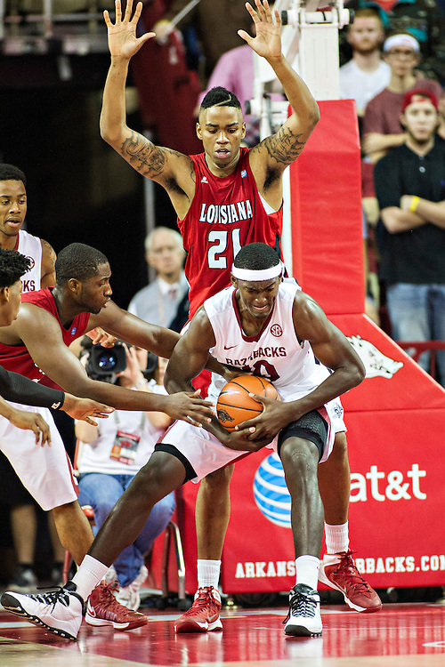 FAYETTEVILLE, AR - NOVEMBER 15:  Bobby Portis #10 of the Arkansas Razorbacks fights for a rebound during a game against the Louisiana Ragin' Cajuns at Bud Walton Arena on November 15, 2013 in Fayetteville, Arkansas.  The Razorbacks defeated the Ragin' Cajuns 76-63.  (Photo by Wesley Hitt/Getty Images) *** Local Caption *** Bobby Portis