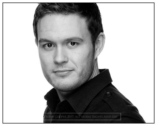 Headshot of actor Jordan Young.
