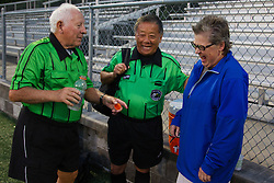 Soccer referee Aubrey Cashman, left, and linesman Henry Woo, center, talk with Barbara Winters LCHS athletic trainer after a soccer match between Lexington Catholic and Henry Clay, Tuesday, Aug. 13, 2013 at Lexington Catholic Soccer/Football Stadium in Lexington. Photo by Jonathan Palmer