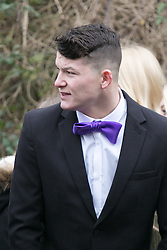 © Licensed to London News Pictures. 18/01/2015. Measham, Leicestershire, UK. The scene outside St Laurence's Church in the centre of Measham for the service of Kayleigh Haywood. A young man wearing a purple bow tie in Kayleigh's favourite colour purple. Photo credit : Dave Warren/LNP