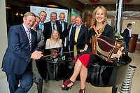 An Taoiseach Enda Kenny with fellow TD's  Ciaran Cannon, Brian Walsh, Pat McDonagh Supermacs, Joe O Neill Galway City Council, John Killeen, Volvo Ocean Race and Michael Coyle Galway Chamber with (seated)managing director of the Volvo Ocean Race in Galway Micheline McNamara met up with Sharon Shannon at the launch of  the first wave of the entertainment line up announced that is part of the Volvo Ocean Race Festival running from June 30 to July 8..Maverick Sabre, Sharon Shannon together with 42-piece Orchestra, The Stunning, Ryan Sheridan, Hot 8 Brass Band, The Kanyu Tree, Túcan, The Deans, Stephen James & Band, The Amazing Apples, Youth Ballet West are the first headliners announced for the grand finale of the Volvo Ocean Race in Galway this summer. Photo:Andrew Downes..