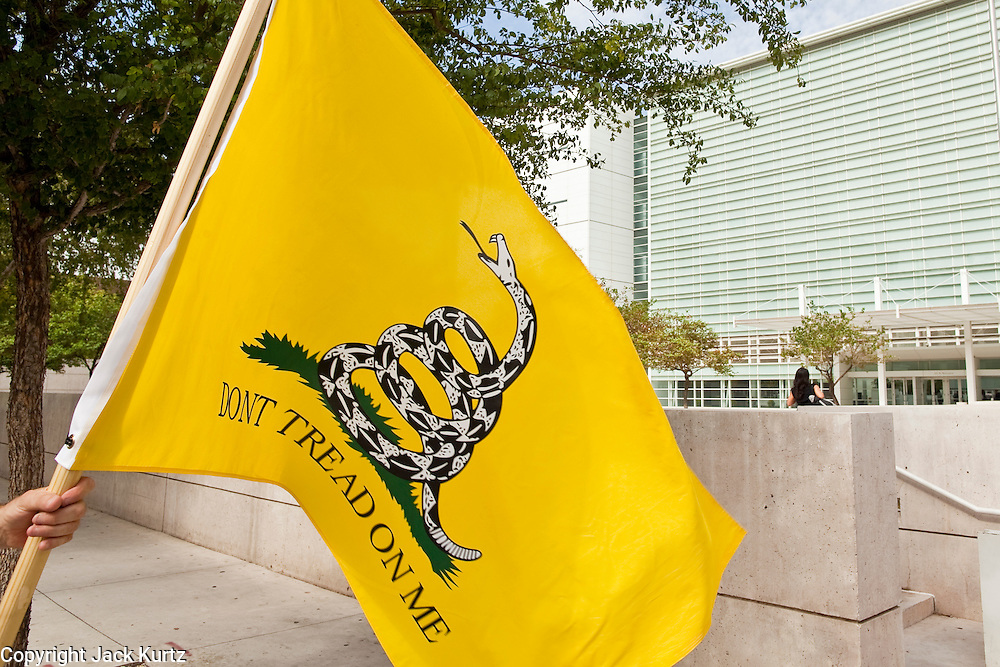 15 JULY 2010 - PHOENIX, AZ: A supporter of 1070 with the Don't Tread On Me flag in front of the courthouse Thursday. People for and against SB 1070 picketed the front of the Sandra Day O'Connor US Courthouse (CQ) in Phoenix Thursday morning during the first hearing against SB 1070.     PHOTO BY JACK KURTZ
