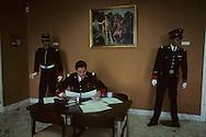 23. The Prince's carabaneers at attention in the barracks of the national guard.   Les carabiniers du prince passant un examen dans la caserne de la garde nationale  R00012/23    L920926a  /  P0000357