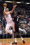 Oct 11, 2017; Phoenix, AZ, USA; Phoenix Suns center Alex Len (21) shoots the ball over Portland Trail Blazers forward Al-Farouq Aminu (8) in the first half at Talking Stick Resort Arena. Mandatory Credit: Jennifer Stewart-USA TODAY Sports