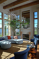 A tranquil view in this airy living room of a lakefront mansion in the Baldwin Park neighborhood in Orlando, Florida.