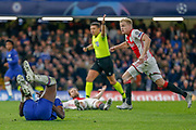 RED CARD Ajax defender Daley Blind (17) fouls Chelsea forward Tammy Abraham (9) and is sent off shortly after during the Champions League match between Chelsea and Ajax at Stamford Bridge, London, England on 5 November 2019.