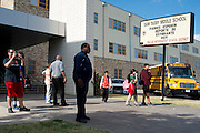 Students and faculty from Sam Tasby Middle School stand outside at the end of the school day in Dallas, Texas on October 1, 2014. Officials confirmed that a student at Sam Tasby Middle School had come in contact with the first confirmed Ebola virus patient in the United States. (Cooper Neill for The New York Times)