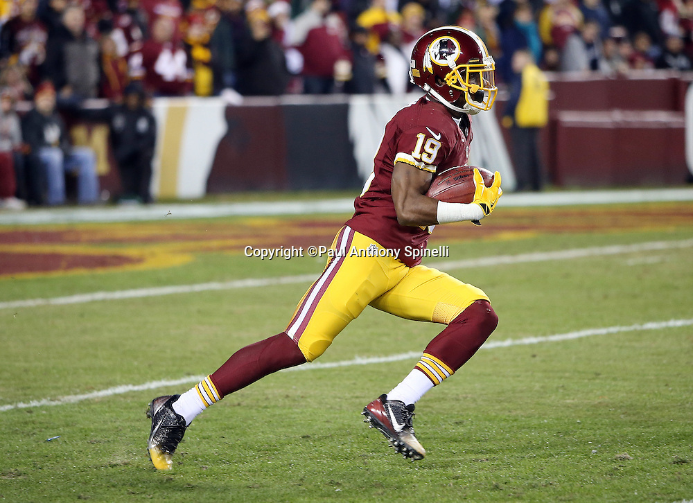 Washington Redskins wide receiver Rashad Ross (19) returns a kick during the 2015 week 13 regular season NFL football game against the Dallas Cowboys on Monday, Dec. 7, 2015 in Landover, Md. The Cowboys won the game 19-16. (©Paul Anthony Spinelli)