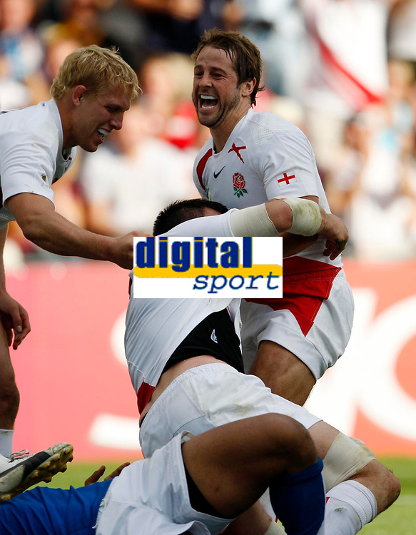 Photo: Richard Lane/Sportsbeat Images.<br />England v Samoa. Pool A, IRB Rugby World Cup, RWC 2007. 22/09/2007. <br />England's Andy Gomarsall (rt) and Lewis Moody celebrate a try scored by Martin Corry (c).
