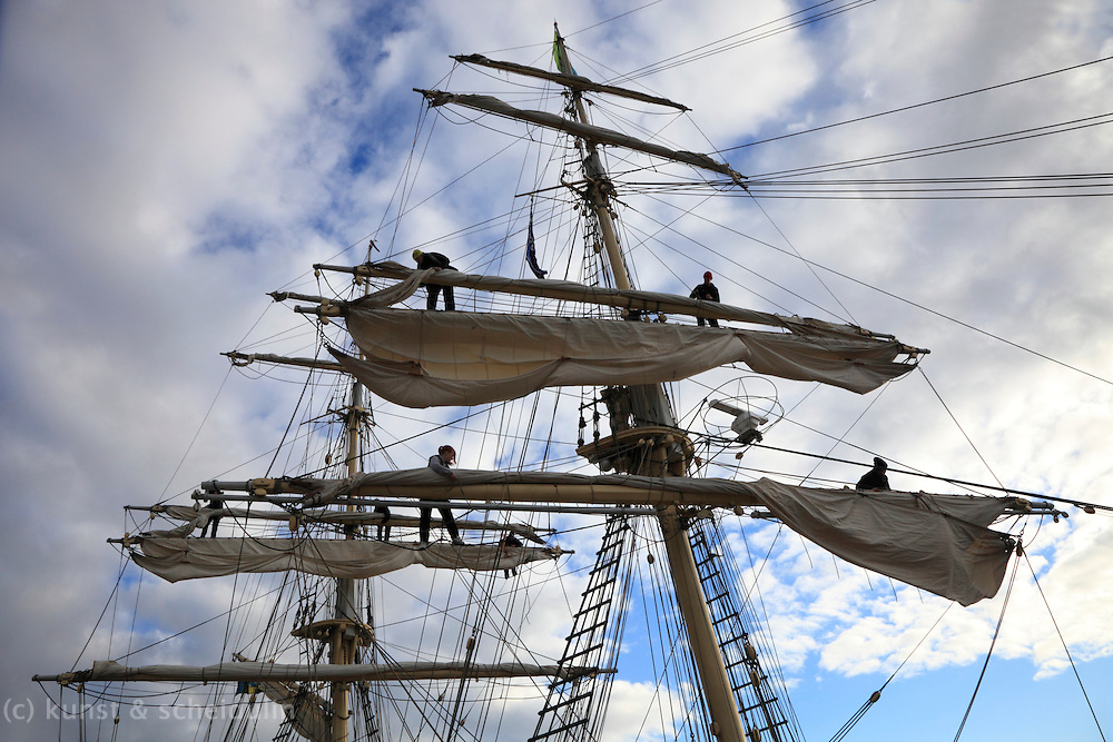 Sailor climbing in the rigging of a brig