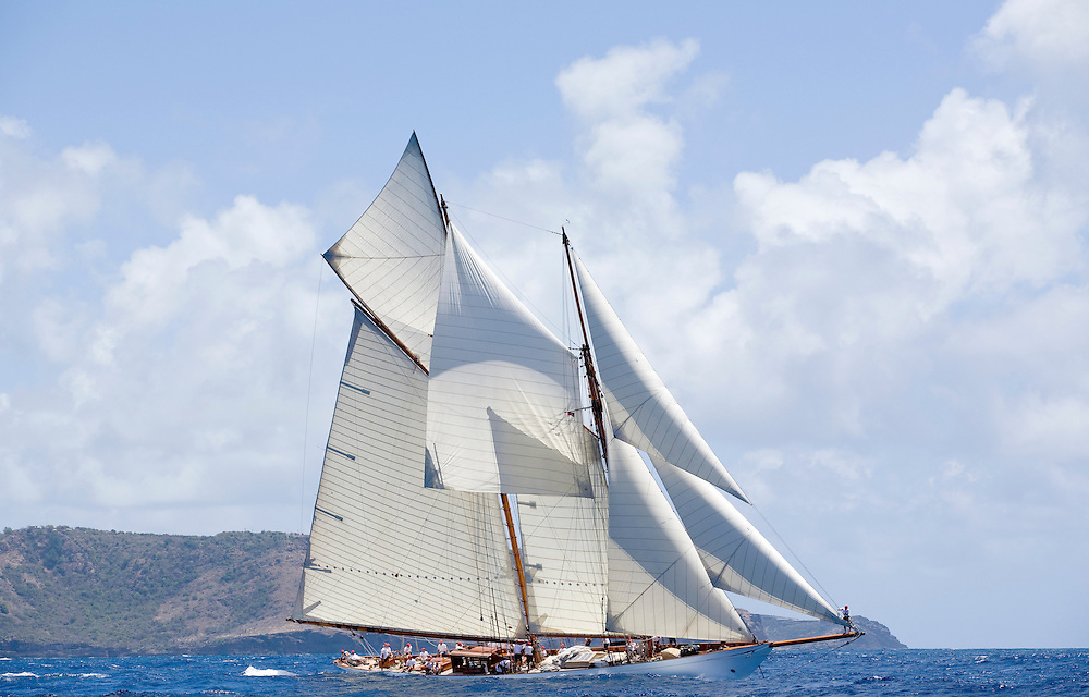 The schooner yacht Altair reaches from the start line with all of her sails flying during Antigua Classic Yacht Regatta. The race  is one of the worlds most prestigious traditional yacht races. Sailing yacht Altair is a 130 foot long , William Fife Designed Gaff schooner