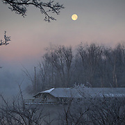 January 31, 2010 - Lexington, Kentucky, USA. A full moon set over a marina and reservoir after a night of single-digit temperatures frosted the trees surrounding the water. (Credit Image: © David Stephenson/ZUMA Press)