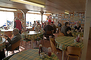 Cafe interior. Small fishing and sailing hamlet of Felixstowe Ferry at the mouth of the River Deben, Suffolk, England