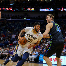 Mar 20, 2018; New Orleans, LA, USA; New Orleans Pelicans forward Anthony Davis (23) drives past Dallas Mavericks center Dirk Nowitzki (41) during the second half at the Smoothie King Center. Pelicans defeated the Mavericks 115-105. Mandatory Credit: Derick E. Hingle-USA TODAY Sports
