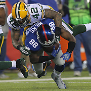 Hakeem Nicks, New York Giants, is tackled by Morgan Burnett, Packers, during the New York Giants Vs Green Bay Packers, NFL American Football match at MetLife Stadium, East Rutherford, New Jersey, USA. 17th November 2013. Photo Tim Clayton