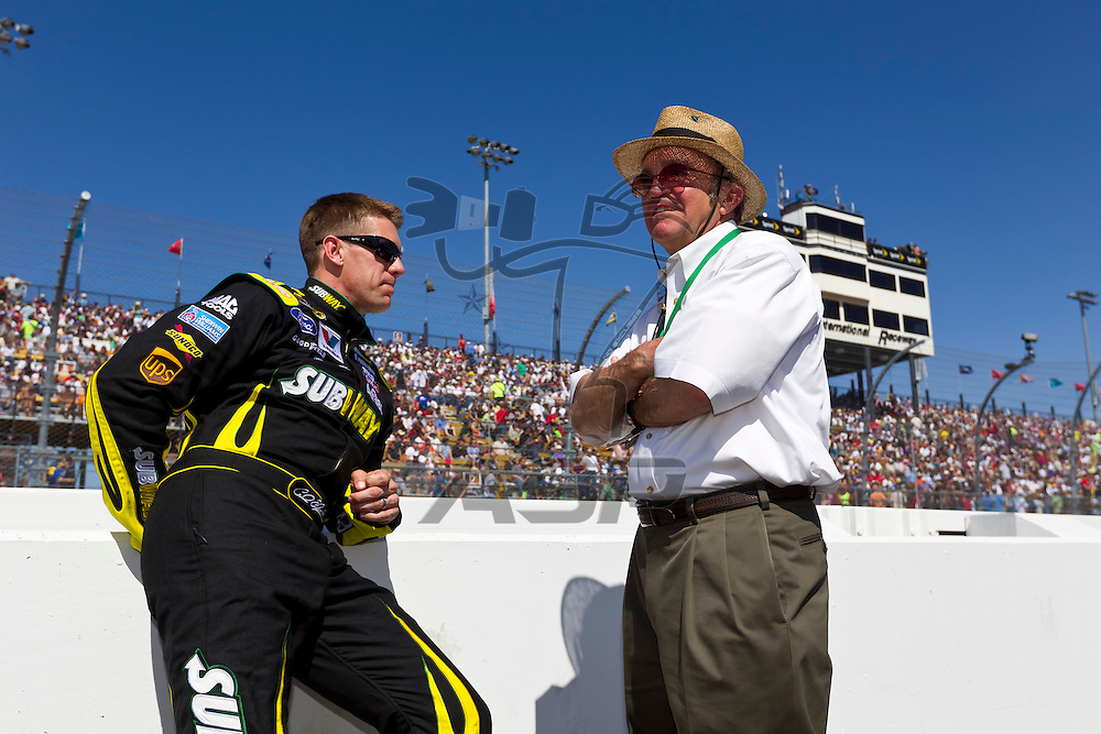 AVONDALE, AZ - MAR 04, 2012:  Carl Edwards (99) talks with owner, Jack Roush, before the start of the Subway Fresh Fit 500 race at the Phoenix International Raceway in Avondale, AZ.
