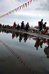 28 April 2013. New Orleans, Louisiana,  USA. .A rain soaked New Orleans Jazz and Heritage Festival. .Photo; Charlie Varley.
