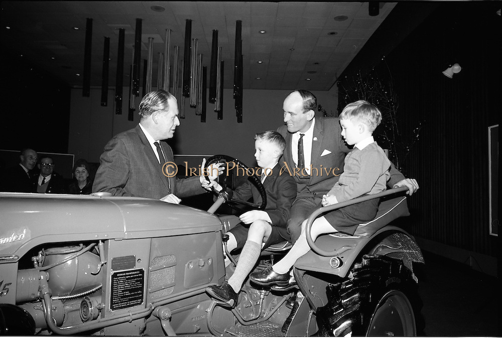 15/12/1964.12/15/1964.15 December 1964.Deutz tractor presented to Alan Keegan at the Intercontinental, Dublin.  Mr R.J. Walby, Managing Director McNeill (Ireland) Ltd handing over the Deutz tractor to 10 year Alan Keegan, with his father Charles keegan and Brother Stewart (6) looking on. Charles Keegan was the 1964 Ploughing World Champion.
