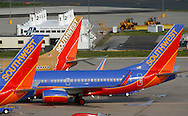 Southwest Airlines jets are parked at the terminal at Philadelphia International Airport May 8, 2005 in Philadelphia, Pennsylvania. Southwest Airlines brought three jets into Philadelphia today in preparation for the start of service at Philadelphia International Airport. (Photo by William Thomas Cain/For The Times)