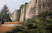 Ramparts and defensive tower, 13th century, with giant outdoor chessboard for visitors, at the medieval castle of Chateau-Thierry, Picardy, France. The first fortifications on this spur over the river Marne date from the 4th century and the first castle was built in the 9th century Merovingian period by the counts of Vermandois. Thibaud II enlarged the castle in the 12th century and built the Tour Thibaud, and Thibaud IV expanded it significantly in the 13th century to include 17 defensive towers in the walls and an East and South gate. The castle was largely destroyed in the French Revolution after having been a royal palace since 1285. In 1814 it was used as a citadel for Napoleonic troops. Picture by Manuel Cohen