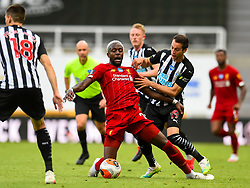 LIVERPOOL, ENGLAND - Sunday, July 26, 2020: Liverpool's Cameron Brannagan (L) and Newcastle United's Javier Manquillo during the final match of the FA Premier League season between Newcastle United FC and Liverpool FC at St. James' Park. The game was played behind closed doors due to the UK government's social distancing laws during the Coronavirus COVID-19 Pandemic. Liverpool won 3-1 and finished the season as Champions on 99 points. (Pic by Propaganda)