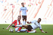 Shane Byrne of Brackley Town (4) and Louis Dennis of Bromley FC (10) battle for the ball during the FA Trophy match between Brackley Town and Bromley at Wembley Stadium, London, England on 20 May 2018. Picture by Stephen Wright.