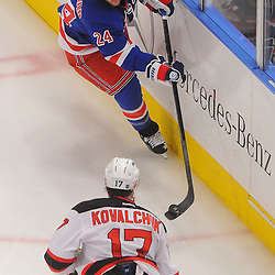 May 14, 2012: New York Rangers right wing Ryan Callahan (24) dumps the puck past New Jersey Devils left wing Ilya Kovalchuk (17) into the Devils' zone on the penalty kill during third period action in game 1 of the NHL Eastern Conference Finals between the New Jersey Devils and New York Rangers at Madison Square Garden in New York, N.Y. The Rangers defeated the Devils 3-0.
