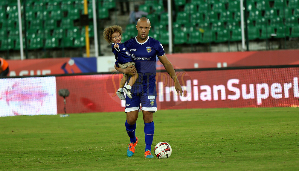 Mikael Silvestre of Chennaiyin FC with his son after the match 50 of the Hero Indian Super League between Chennaiyin FC and FC Goa held at the Jawaharlal Nehru Stadium, Chennai, India on the 5th December 2014.<br /> <br /> Photo by:  Sandeep Shetty/ ISL/ SPORTZPICS