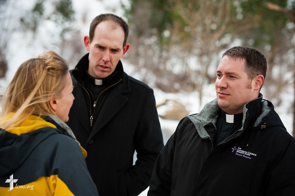 (L-R) The Rev. Seth Clemmer, pastor of Mt. Calvary Lutheran Church, and the Rev. Michael W. Meyer, manager of LCMS Disaster Response, talk to Deyn Johnson, owner of Whispering Pines Cottages on the River, about her flood-damaged business in Estes Park, Colo., on Tuesday, Jan. 7, 2014. LCMS Communications/Erik M. Lunsford
