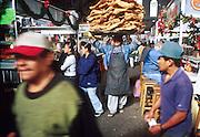 16 JANUARY 2002, GUANAJUATO, GUANAJUATO, MEXICO: A chicharone (fried pork skins) vendor walks through the market in the city of Gunajuato, state of Guanajuato, Mexico, Jan. 16, 2002. PHOTO BY JACK KURTZ