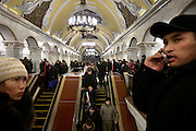 Tajik immigrants talk on the phone inside the Komsomolskaya metro station in Moscow. This station serves three of the Russian capital's main railway terminals..The Moscow Metro, which spans almost the entire Russian capital, is the world's second most heavily used metro system after the Tokyo's twin subway. Opened in 1935, it is well known for the ornate design of many of its stations, which contain outstanding examples of socialist realist art.