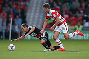 Doncaster Rovers midfielder, on loan from Chelsea, Jordan Houghton (16)  fouls Nottingham Forest midfielder David Vaughan (24)  during the EFL Cup match between Doncaster Rovers and Nottingham Forest at the Keepmoat Stadium, Doncaster, England on 9 August 2016. Photo by Simon Davies.