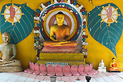 Detail of Buddhist shrine at roadside devale to God Kataragama. Wellawaya - Koslanda Road.
