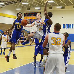 Staff photos by Tom Kelly IV<br /> East's Kyle Tucker (12) goes up for a layup during the Downingtown East vs Ben Franklin game at Downingtown West High School on Friday December 6, 2013.
