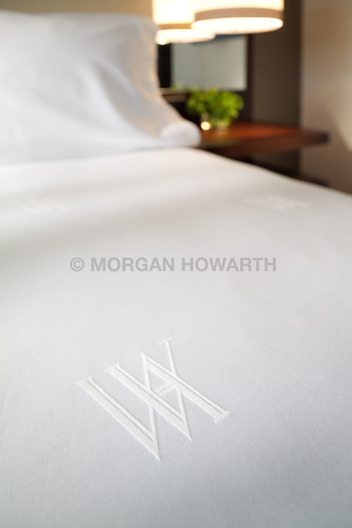 Marriott Hotel bedroom with white sheet set and queen bed Monogram
