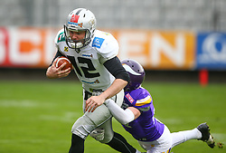 01.04.2017, Tivoli Stadion, Innsbruck, AUT, AFL, Swarco Raiders Tirol vs Dacia Vikings Vienna, im Bild Sean Shelton (Swarco Raiders Tirol, #12, QB) und Sebastian Wimmer (Dacia Vikings Vienna, #37, DB) // during the Austrian Football League game between Swarco Raiders Tirol and Dacia Vikings Vienna at the Tivoli Stadion, Innsbruck, Austria on 2017/04/01. EXPA Pictures © 2017, PhotoCredit: EXPA/ Thomas Haumer