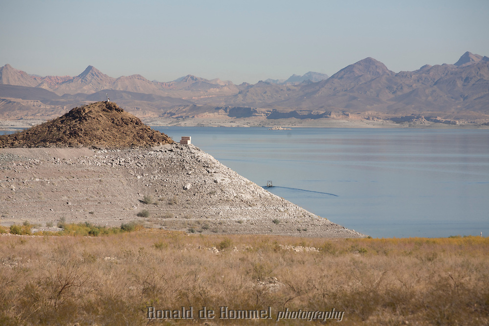 Former Islands in Lake Mead are now connected to the mainland because the water level has gone down tremendously in the last 10 years.<br /> Because of a ten year drought in the south west, the level of Lake Mead has gone down more than 50 feet (17m). Currently the lake is at approximately 50 percent of it's capacity. A big danger for cities like Las Vegas that rely on its water. Due to climate change this level could drop even more. 7 States in the US and two in Mexico rely on the water of the Colorado River. <br /> <br /> Copyright Johannes Abeling / Ronald de Hommel
