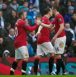 MANCHESTER, ENGLAND - Sunday, January 8, 2012: Manchester United's Wayne Rooney celebrates scoring the third goal against Manchester City from the penalty spot with team-mate Michael Carrick during the FA Cup 3rd Round match at the City of Manchester Stadium. (Pic by Vegard Grott/Propaganda)