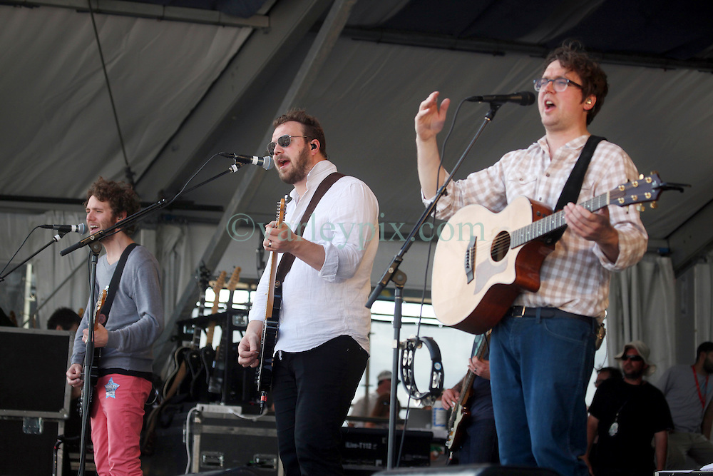 27 April 2012. New Orleans, Louisiana,  USA. .New Orleans Jazz and Heritage Festival. .British indie rock band Gomez plays the Gentilly stage. Ian Ball (l), Ben Ottewell (mid) and Tom Gray enjoy the gig..Photo; Charlie Varley.