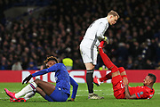 Bayern Munich goalkeeper Manuel Neuer helps team-mate Bayern Munich defender Jerome Boateng while Chelsea forward Tammy Abraham is on the floor during the Champions League match between Chelsea and Bayern Munich at Stamford Bridge, London, England on 25 February 2020.