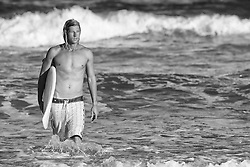 2013 September 07: Surfer Nick Tudor at Wrightsville Beach, North Carolina.
