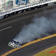 Sprint Cup Series driver Carl Edwards (99) smokes out of turn 4 during the Daytona 500 at Daytona International Speedway on February 20, 2011 in Daytona Beach, Florida. (AP Photo/Alex Menendez)