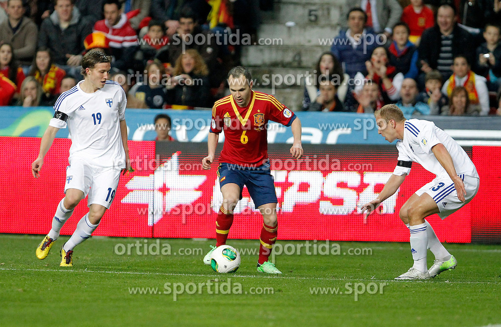 22.03.2013, El Molinon, Gijon, ESP, FIFA WM Qualifikation, Spanien vs Finnland, im Bild Spain's Andres Iniesta (c) and Finland's Ring (l) and Moisander // during the FIFA World Cup Qualifier Match between Spain and Finland at the El Molinon Stadium, Gijon, Spain on 2013/03/22. EXPA Pictures © 2013, PhotoCredit: EXPA/ Alterphotos/ Ricky Blanco..***** ATTENTION - OUT OF ESP and SUI *****