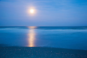 FullMoon rising with reflection in ocean