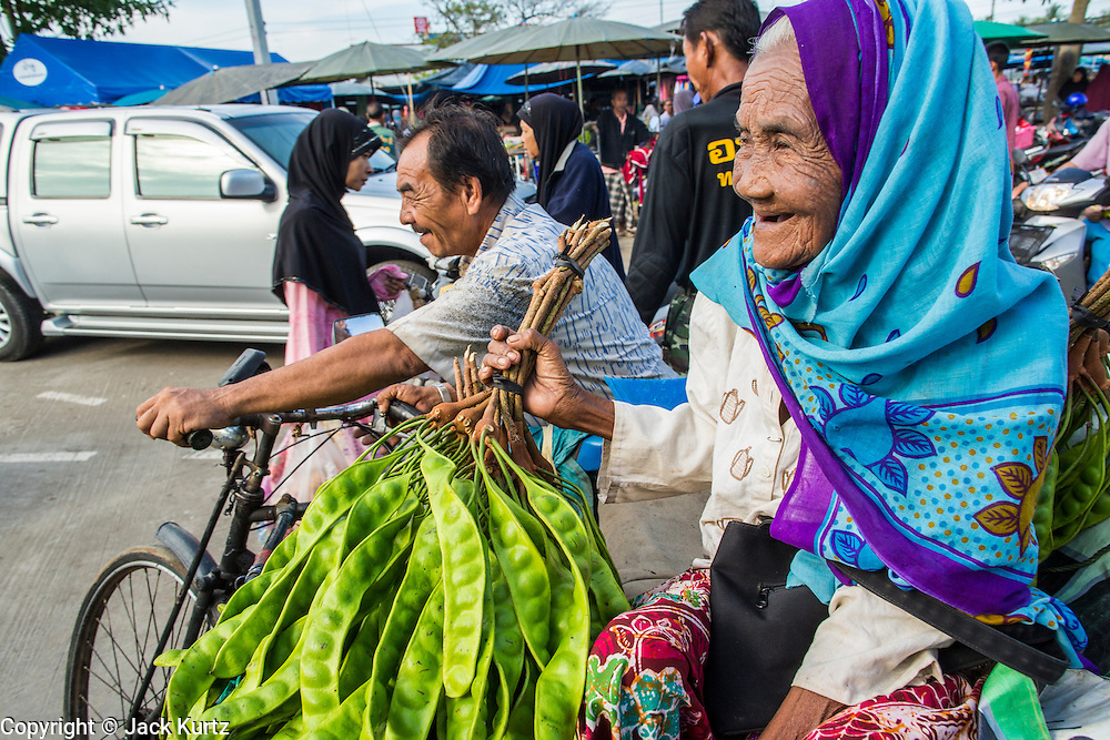 25 OCTOBER 2012 - PATTANI, PATTANI, THAILAND: A woman vendor in the market in Pattani, Thailand.      PHOTO BY JACK KURTZ