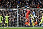 Dinamo Zagreb goalkeeper Dominik Livakovic (40) gets up to punch clear from Manchester City defender Nicolas Otamendi (30) during the Champions League match between Manchester City and Dinamo Zagreb at the Etihad Stadium, Manchester, England on 1 October 2019.